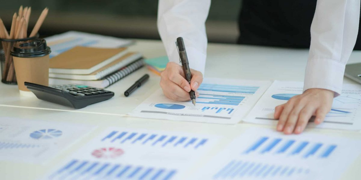 New generation of business professionals analyze their investment plans with charts and graphs.